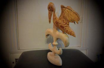 Pelican on fleur de lis on football base by Gail Cavalier