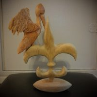Pelican on fleur de lis on football base by Gail Cavalier