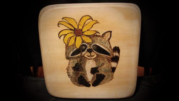 Rocky Raccoon and flower