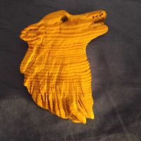 Woodworking art - Wolf's head - by Gail Cavalier
