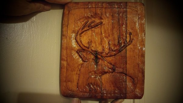deer on wooden plaque