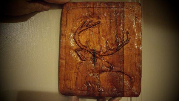 deer on wooden plaque