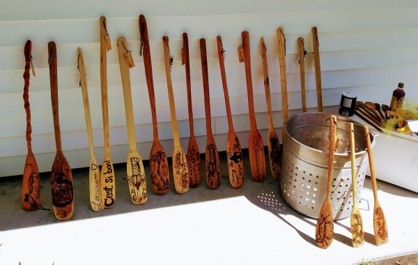 Hand-made Cajun seafood boil wooden paddles